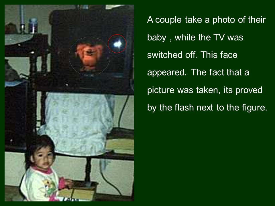 A couple take a photo of their baby , while the TV was switched off