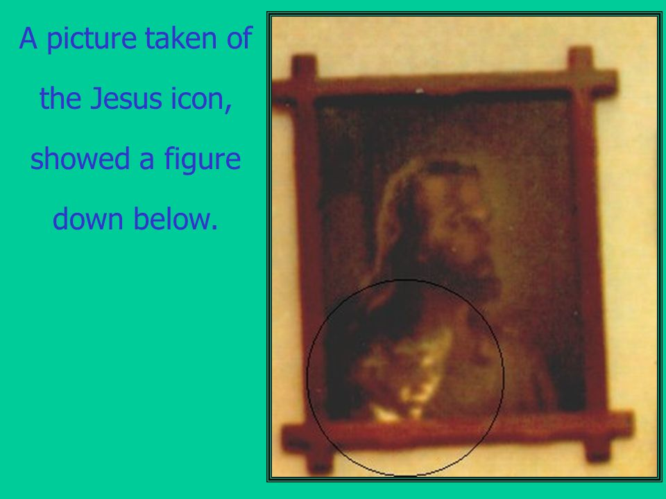A picture taken of the Jesus icon, showed a figure down below.
