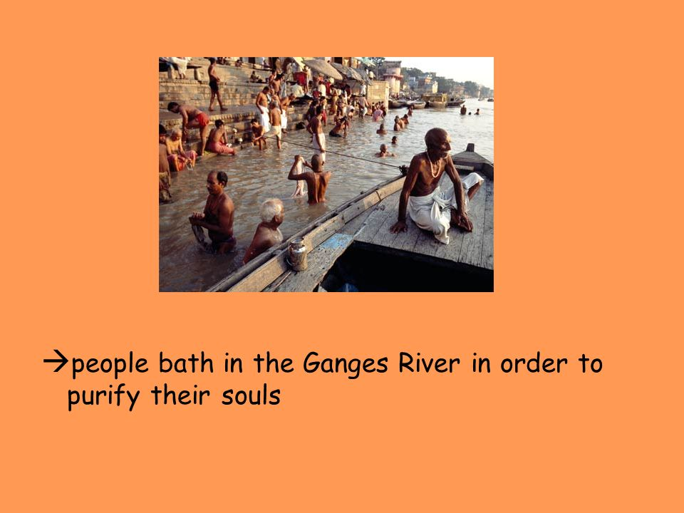 people bath in the Ganges River in order to purify their souls