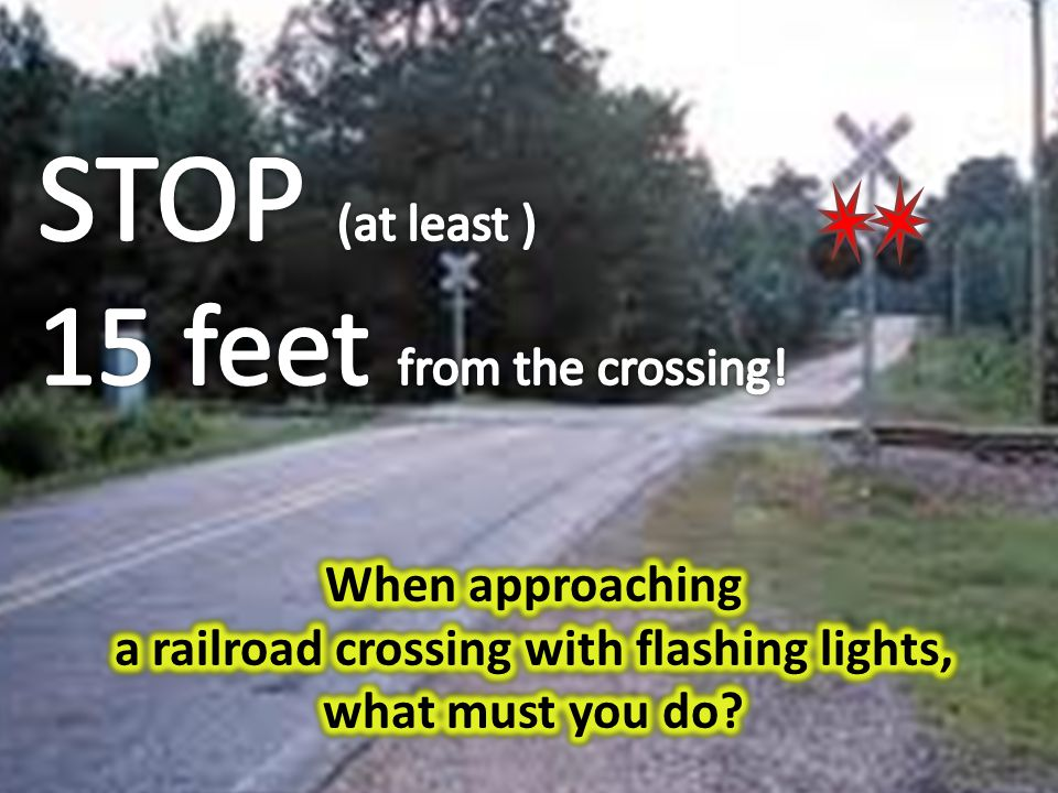 a railroad crossing with flashing lights,