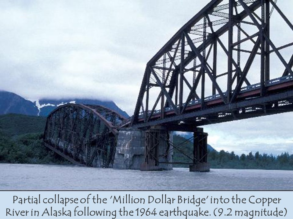 Partial collapse of the Million Dollar Bridge into the Copper River in Alaska following the 1964 earthquake.
