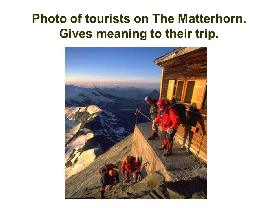 Photo of tourists on The Matterhorn. Gives meaning to their trip.
