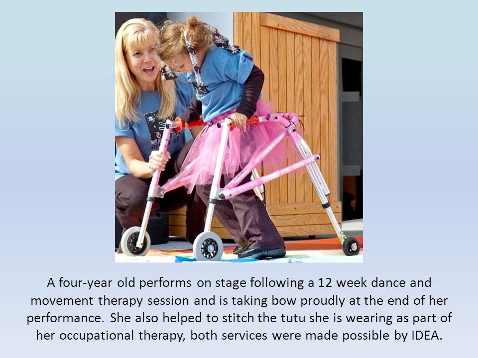 A four-year old performs on stage following a 12 week dance and movement therapy session and is taking bow proudly at the end of her performance.