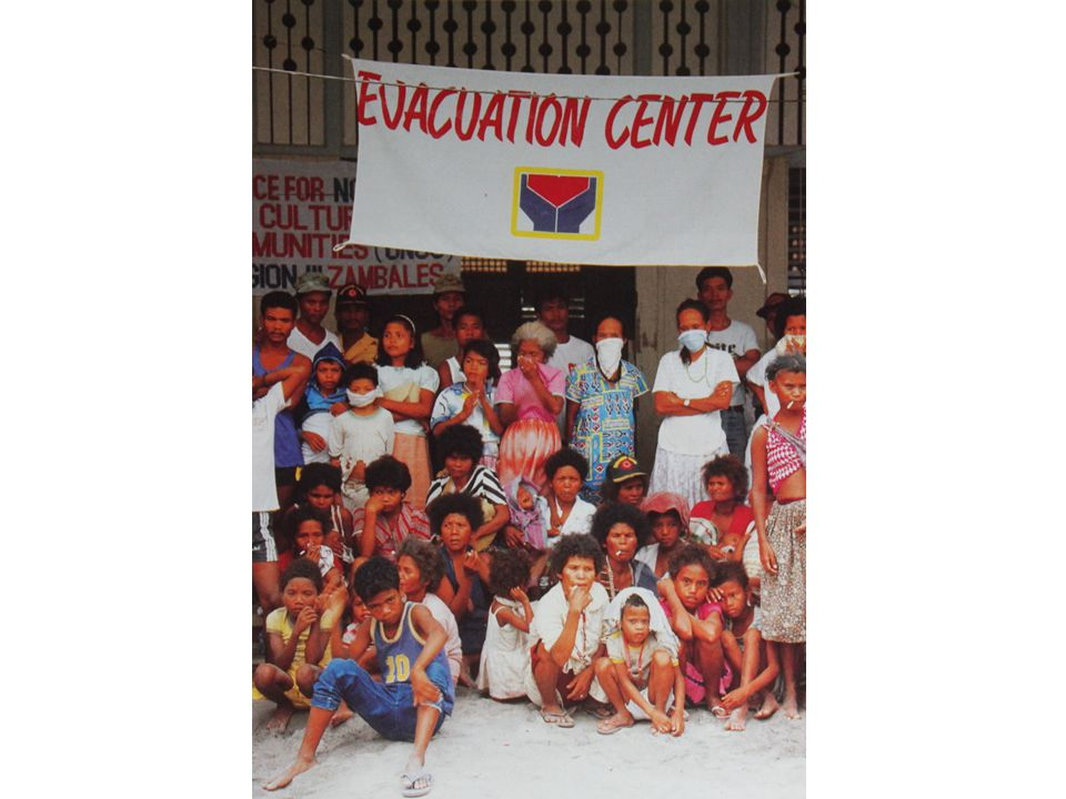 People flee to evacuation centers during the Mt Pinatubo eruption of 1991.