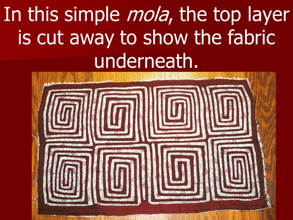 In this simple mola, the top layer is cut away to show the fabric underneath.