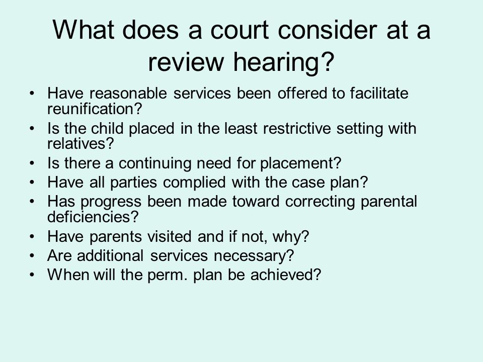 What does a court consider at a review hearing