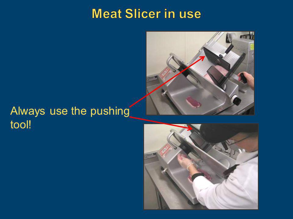 Meat Slicer in use Always use the pushing tool!
