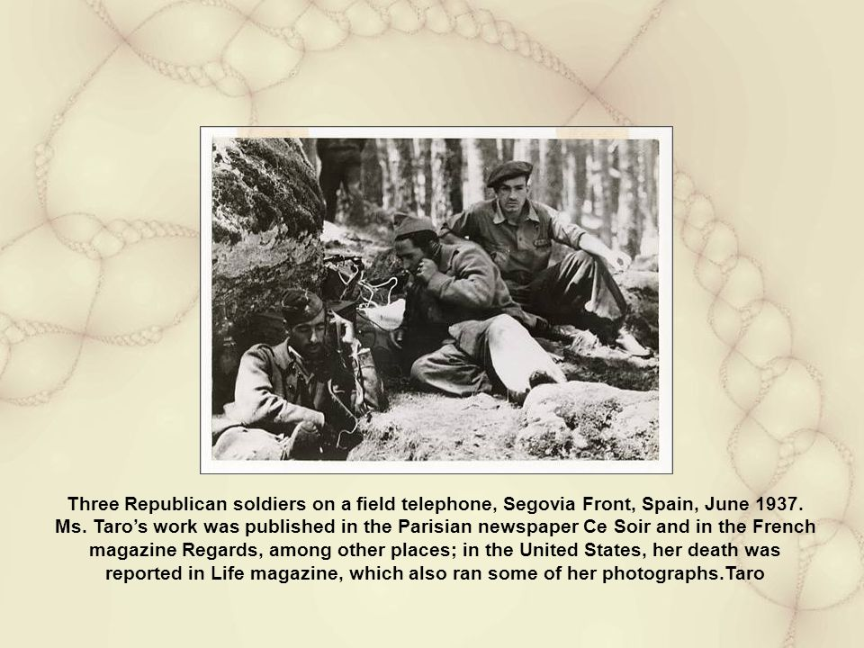 Three Republican soldiers on a field telephone, Segovia Front, Spain, June 1937.