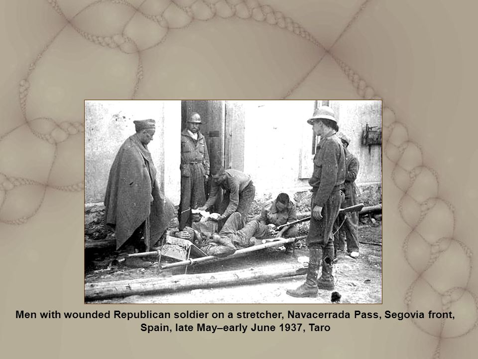 Men with wounded Republican soldier on a stretcher, Navacerrada Pass, Segovia front, Spain, late May–early June 1937, Taro
