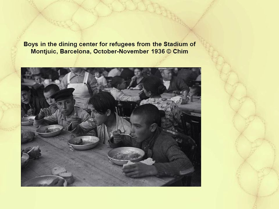 Boys in the dining center for refugees from the Stadium of Montjuic, Barcelona, October-November 1936 © Chim