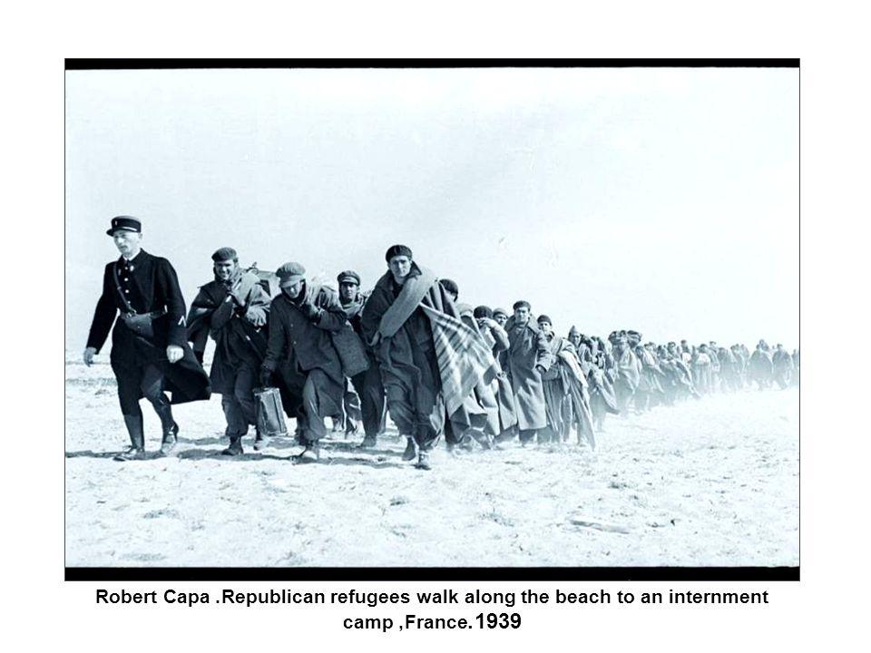 Robert Capa. Republican refugees walk along the beach to an internment camp, France1939.