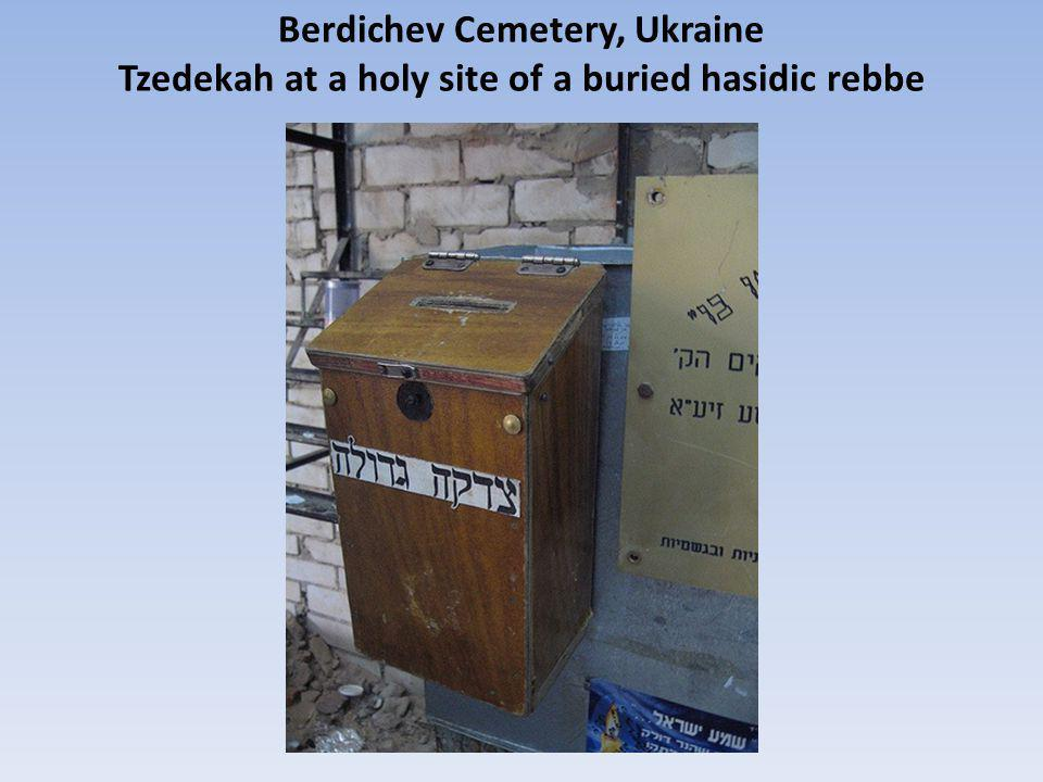 Berdichev Cemetery, Ukraine Tzedekah at a holy site of a buried hasidic rebbe