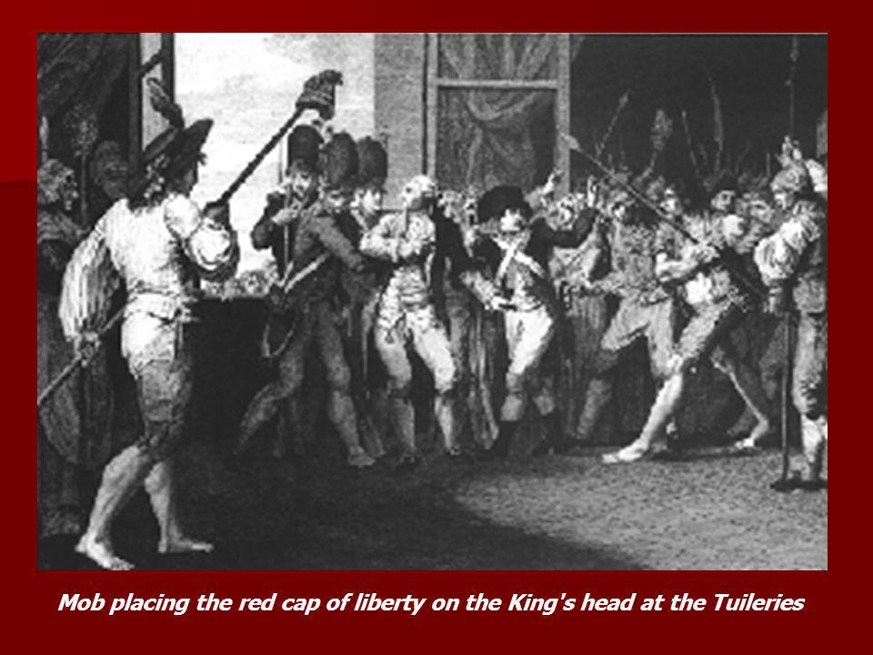 Mob placing the red cap of liberty on the King s head at the Tuileries