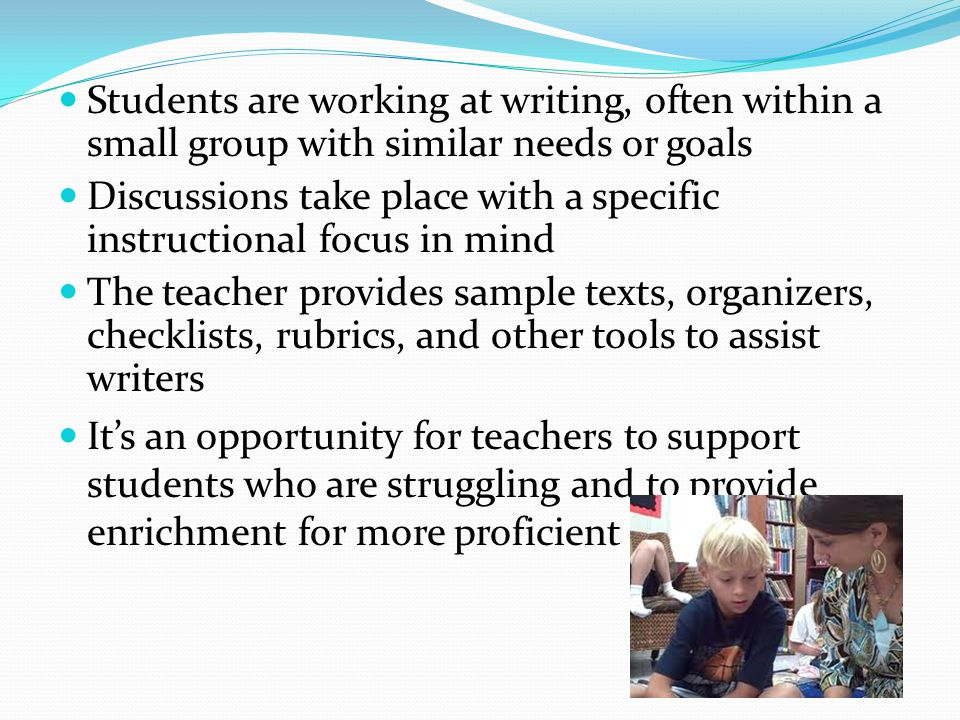 Students are working at writing, often within a small group with similar needs or goals