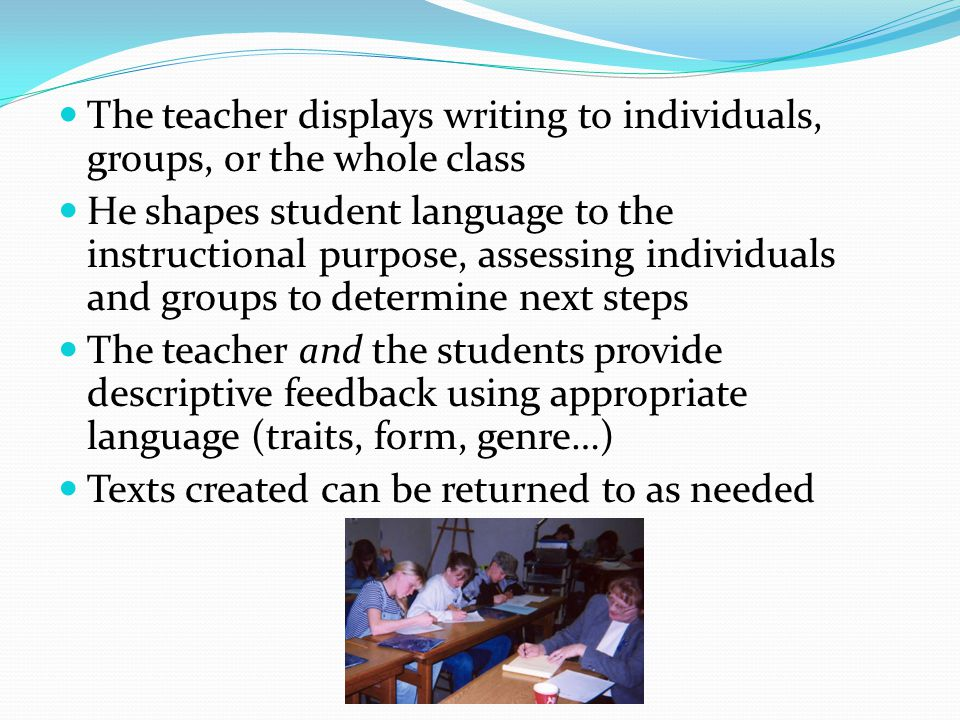 The teacher displays writing to individuals, groups, or the whole class