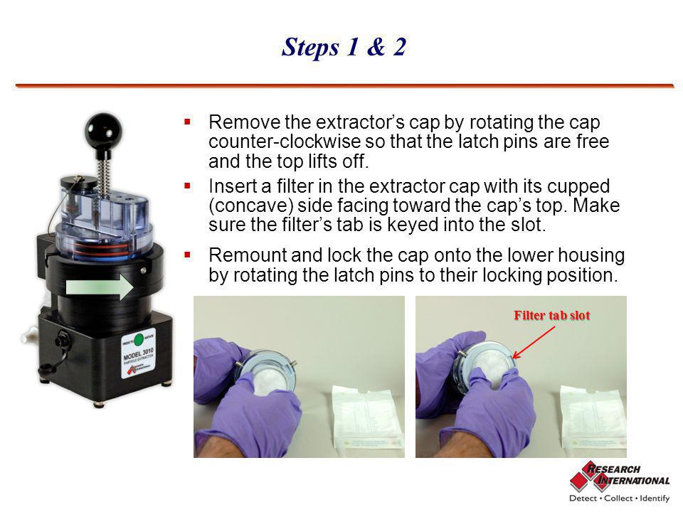 Steps 1 & 2 Remove the extractor's cap by rotating the cap counter-clockwise so that the latch pins are free and the top lifts off.