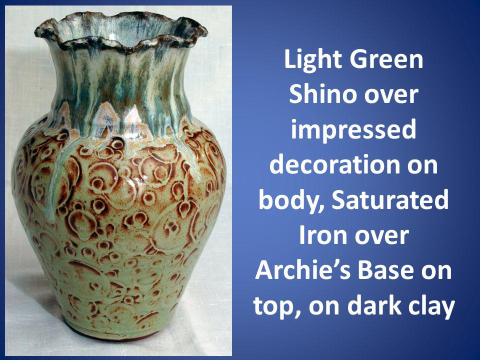 Light Green Shino over impressed decoration on body, Saturated Iron over Archie's Base on top, on dark clay