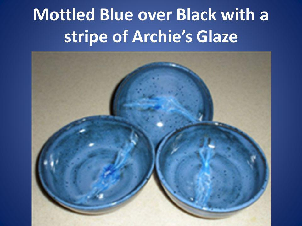 Mottled Blue over Black with a stripe of Archie's Glaze