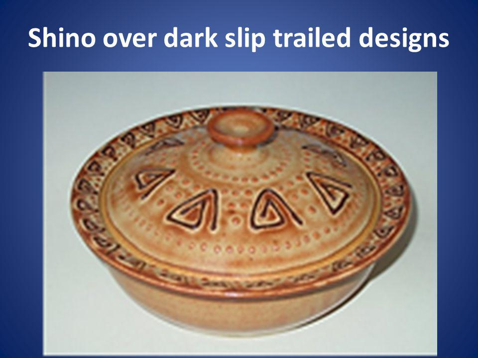 Shino over dark slip trailed designs