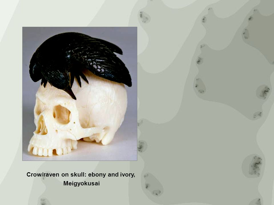 Crow/raven on skull: ebony and ivory,
