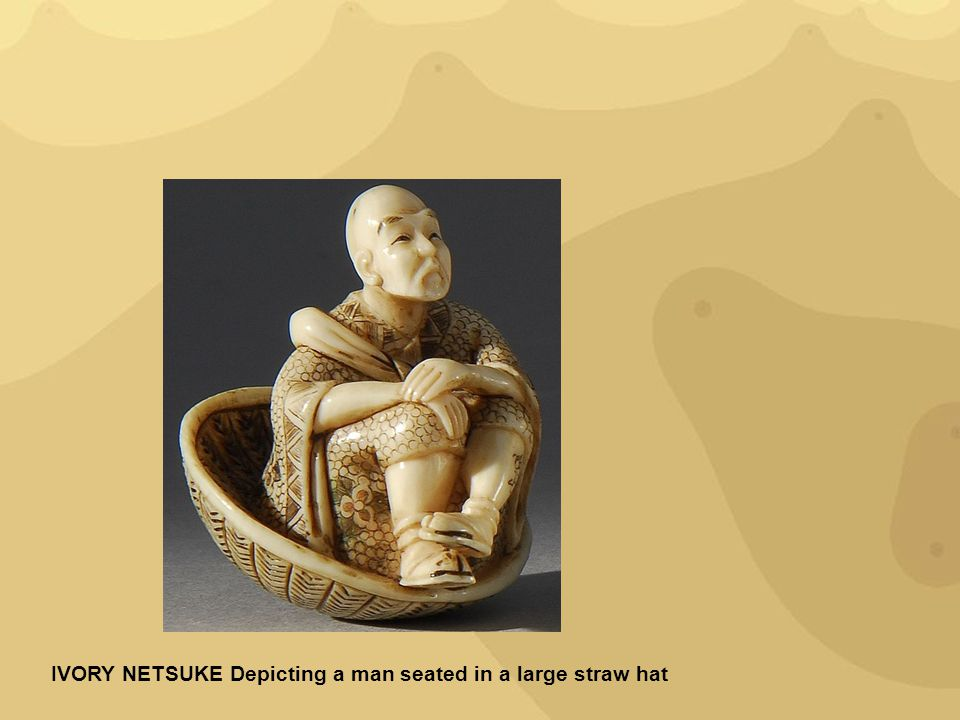 IVORY NETSUKE Depicting a man seated in a large straw hat