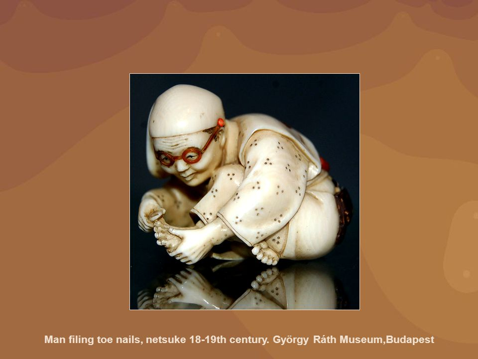 Man filing toe nails, netsuke 18-19th century
