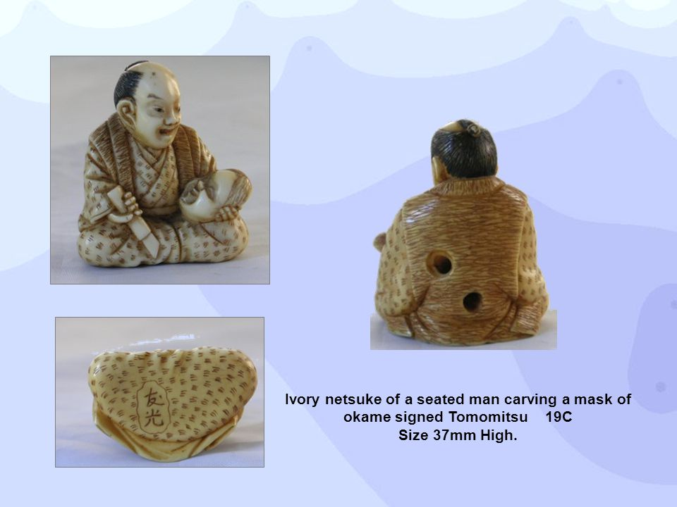 Ivory netsuke of a seated man carving a mask of okame signed Tomomitsu 19C Size 37mm High.