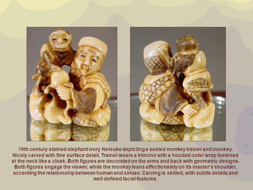 19th century stained elephant ivory Netsuke depicting a seated monkey trainer and monkey.
