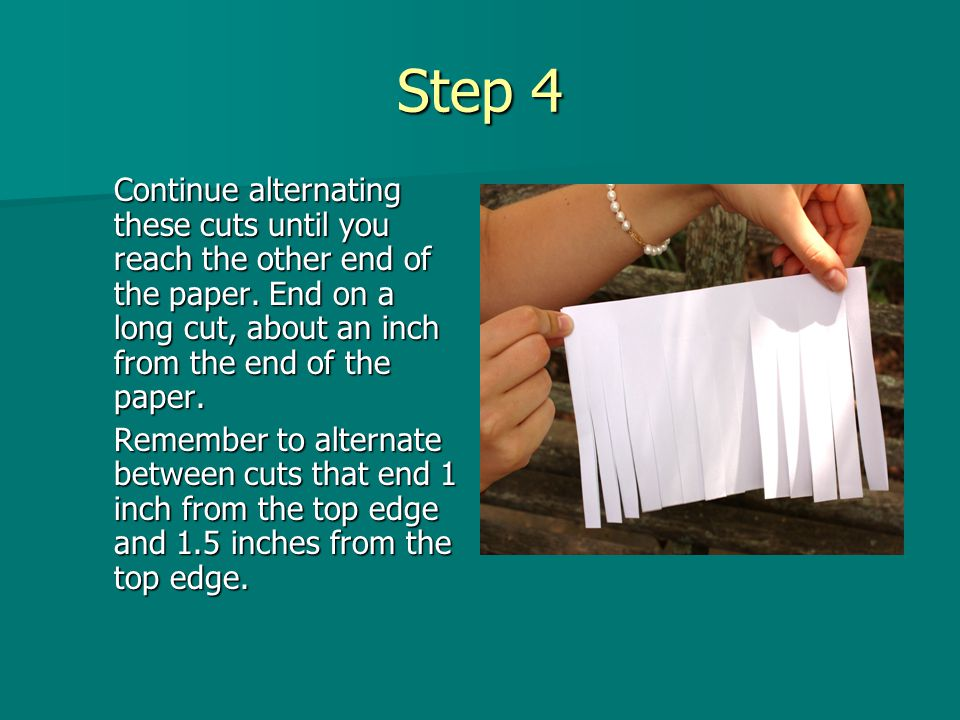 Step 4 Continue alternating these cuts until you reach the other end of the paper. End on a long cut, about an inch from the end of the paper.
