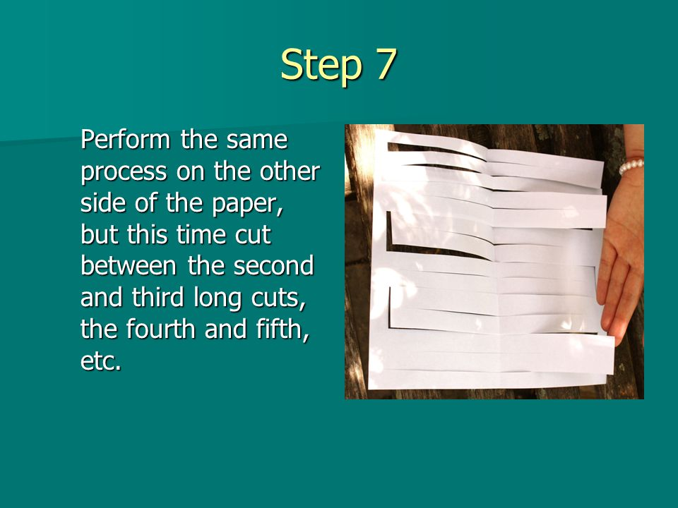 Step 7 Perform the same process on the other side of the paper, but this time cut between the second and third long cuts, the fourth and fifth, etc.