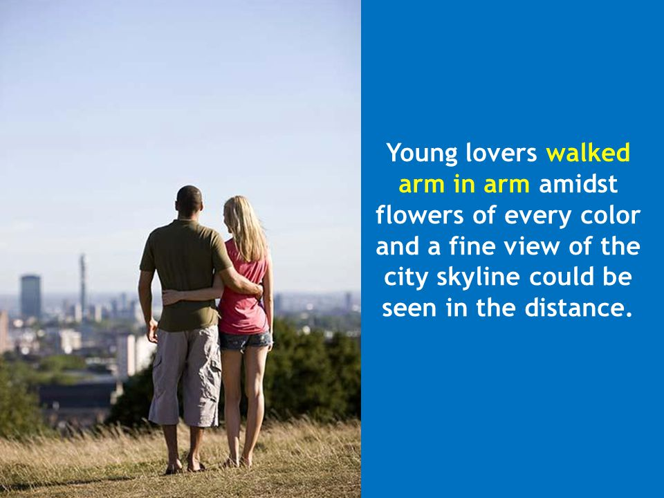 Young lovers walked arm in arm amidst. flowers of every color. and a fine view of the. city skyline could be.