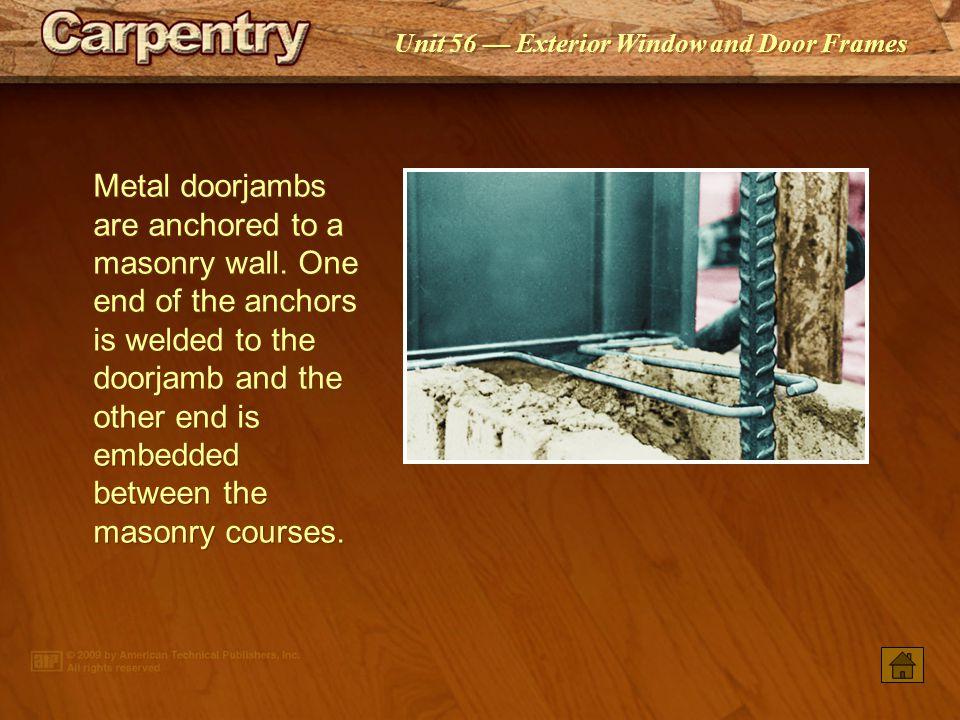 Metal doorjambs are anchored to a masonry wall