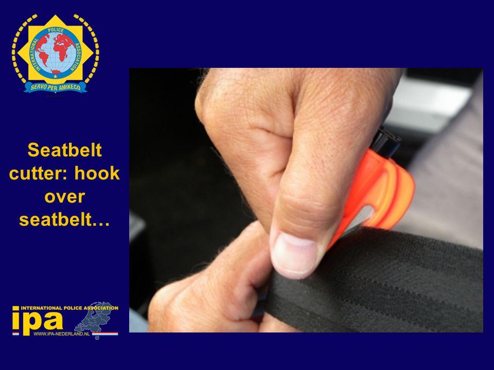 Seatbelt cutter: hook over seatbelt…
