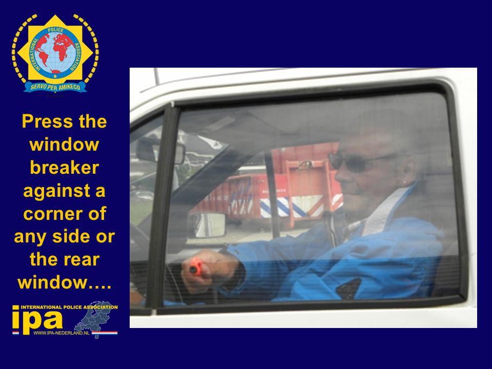 Press the window breaker against a corner of any side or the rear window….