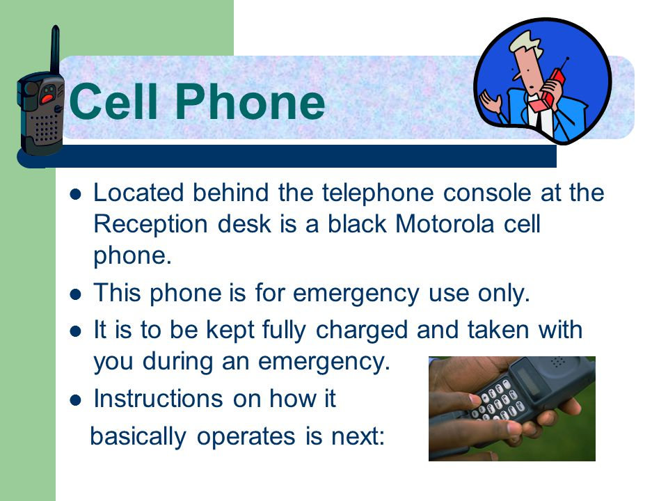Cell Phone Located behind the telephone console at the Reception desk is a black Motorola cell phone.