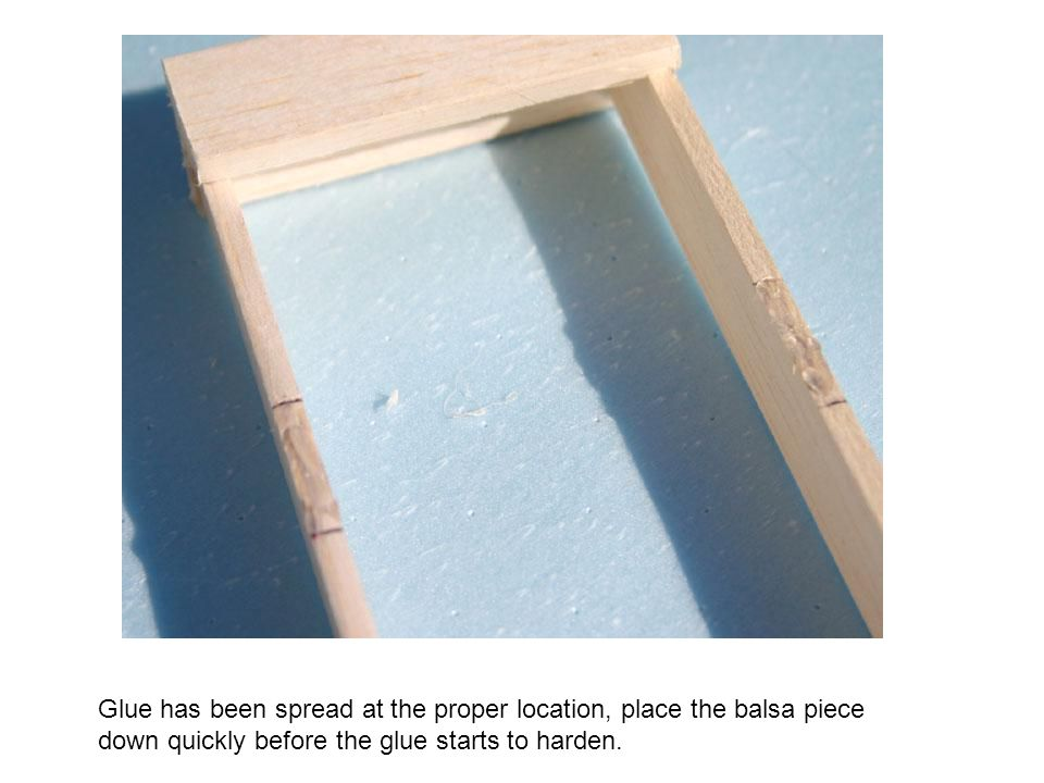 Glue has been spread at the proper location, place the balsa piece down quickly before the glue starts to harden.