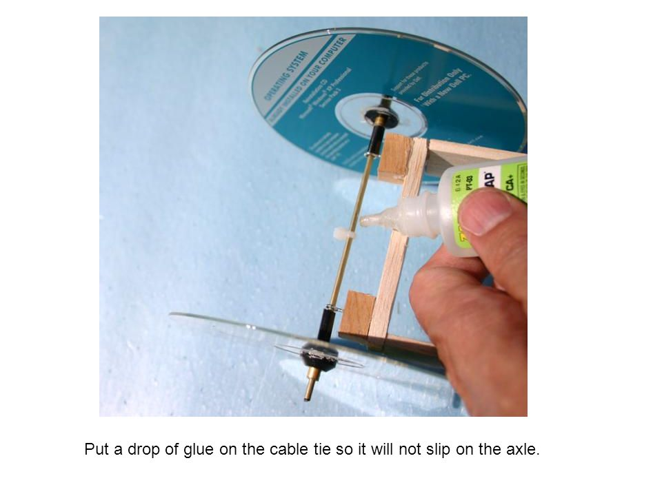 Put a drop of glue on the cable tie so it will not slip on the axle.