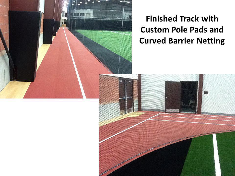 Finished Track with Custom Pole Pads and Curved Barrier Netting