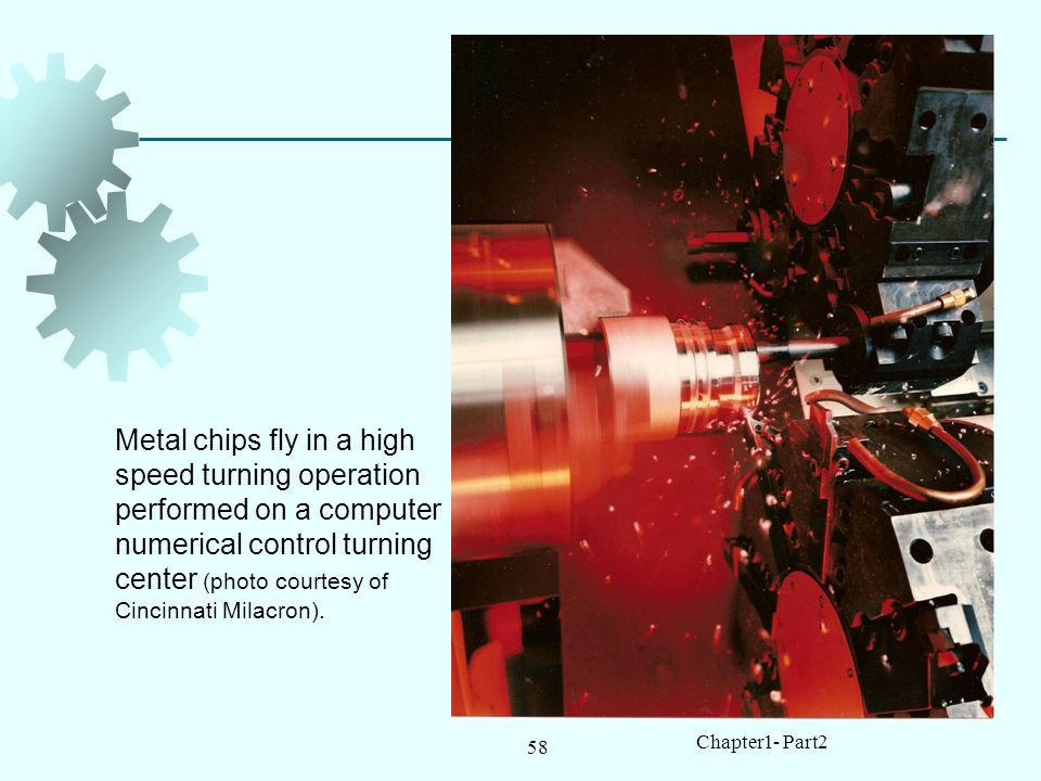 Metal chips fly in a high speed turning operation performed on a computer numerical control turning center (photo courtesy of Cincinnati Milacron).