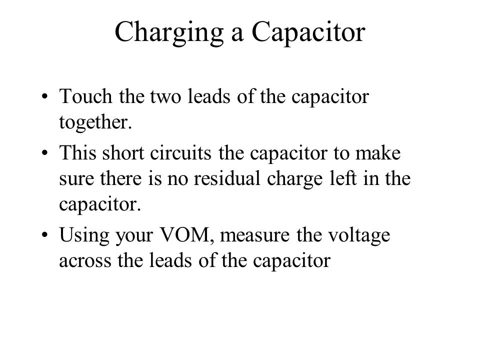 Charging a Capacitor Touch the two leads of the capacitor together.