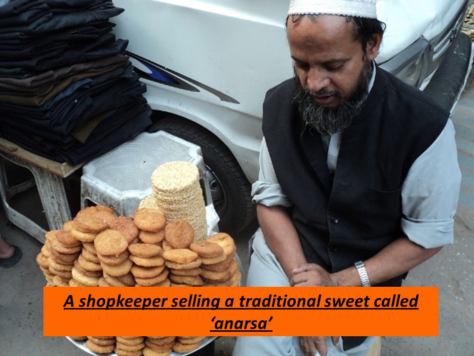 A shopkeeper selling a traditional sweet called 'anarsa'