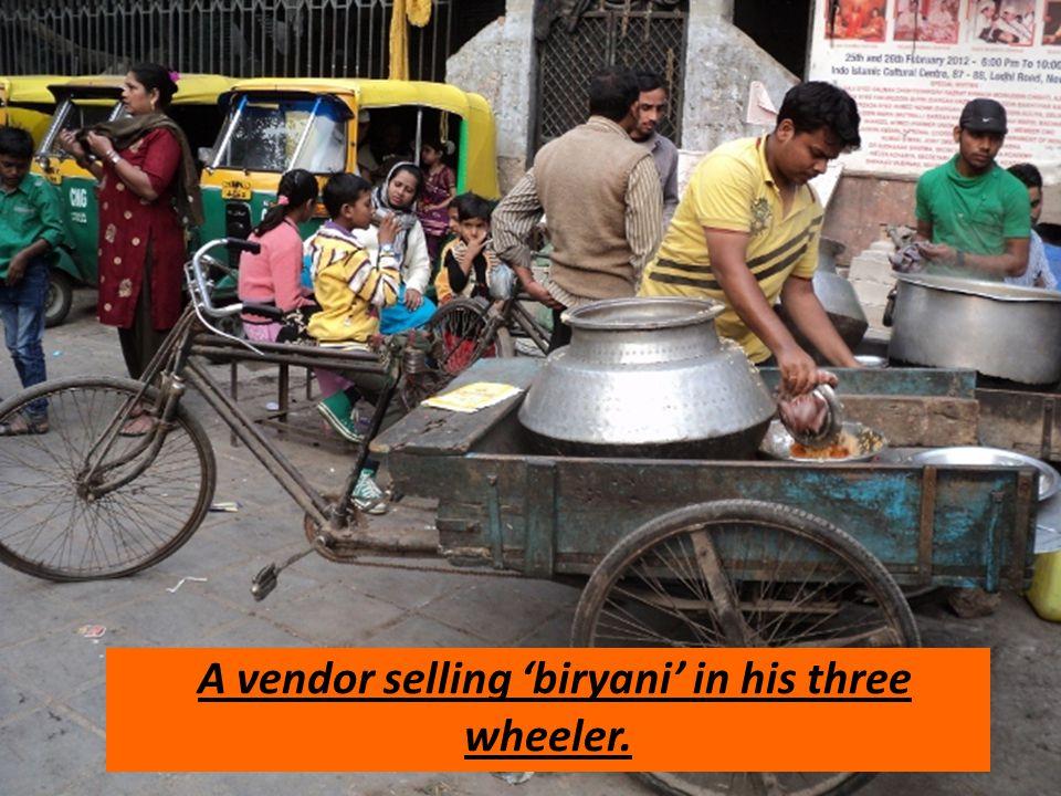 A vendor selling 'biryani' in his three wheeler.