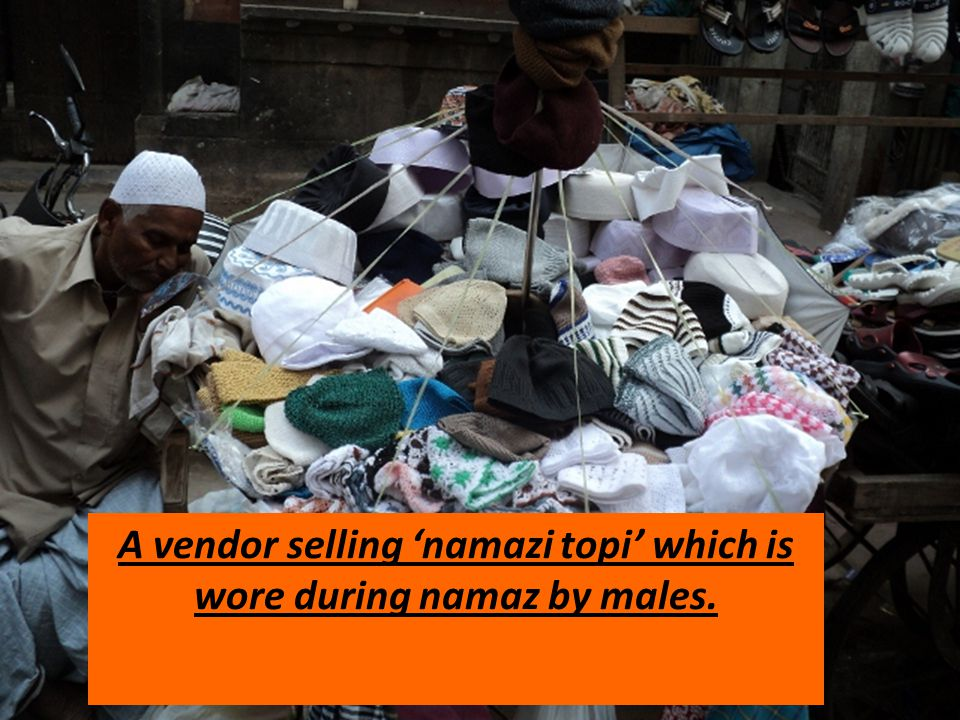A vendor selling 'namazi topi' which is wore during namaz by males.