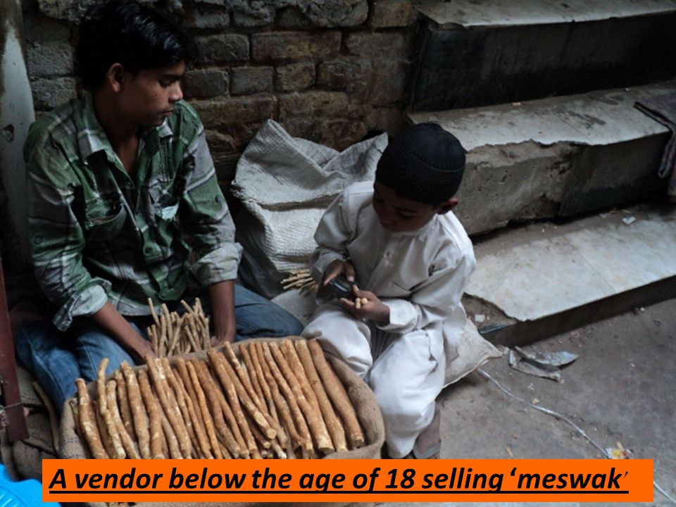 A vendor below the age of 18 selling 'meswak'