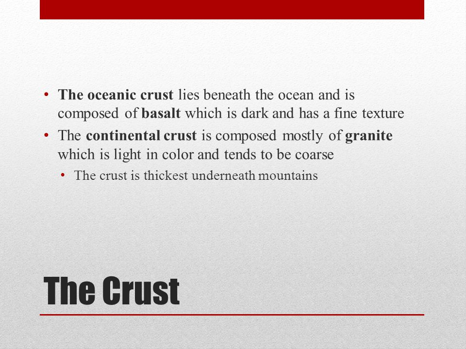 The oceanic crust lies beneath the ocean and is composed of basalt which is dark and has a fine texture