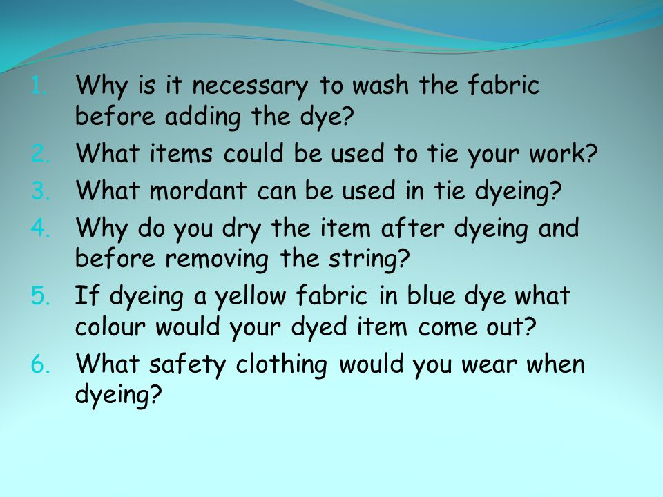 Why is it necessary to wash the fabric before adding the dye