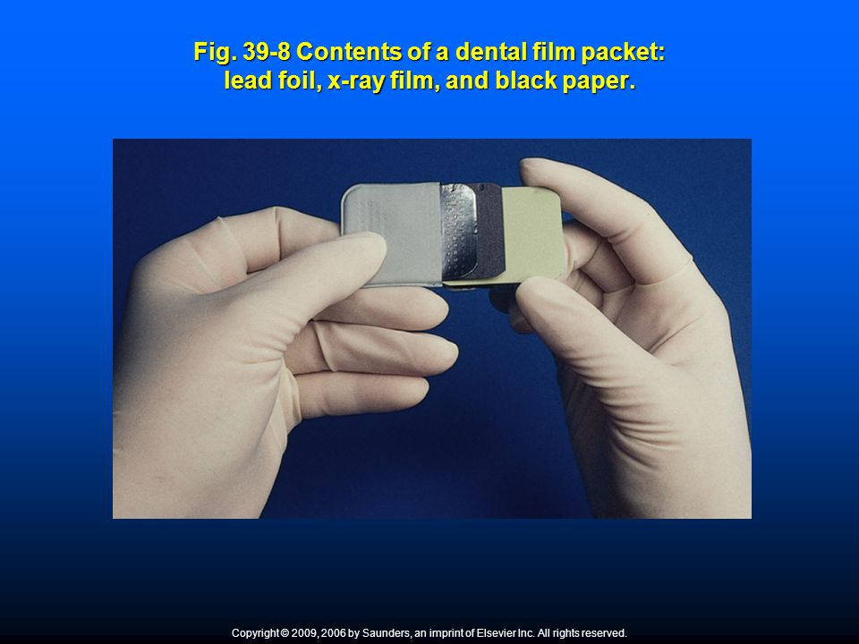 Fig. 39-8 Contents of a dental film packet: lead foil, x-ray film, and black paper.