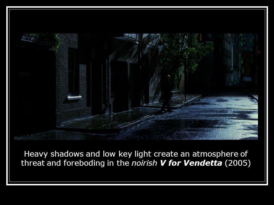 Heavy shadows and low key light create an atmosphere of threat and foreboding in the noirish V for Vendetta (2005)