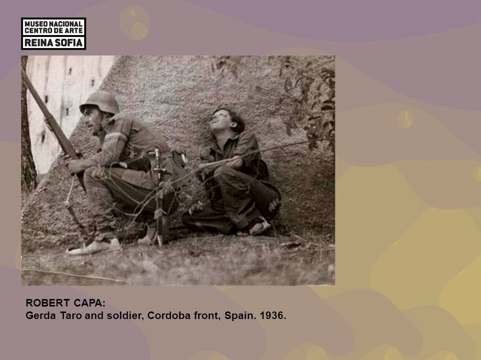 ROBERT CAPA: Gerda Taro and soldier, Cordoba front, Spain. 1936.