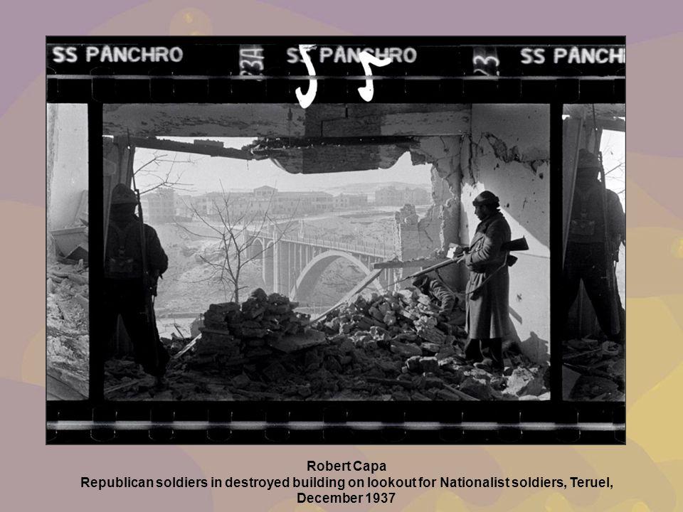 Teruel Robert Capa Republican soldiers in destroyed building on lookout for Nationalist soldiers, Teruel, December 1937.
